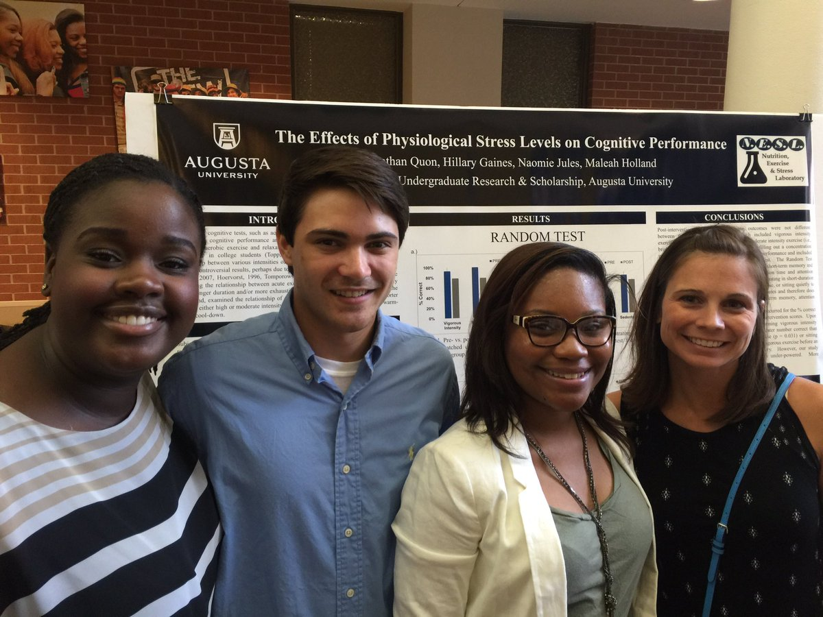Dr. Maleah Holland (far right) lead students Naomie Jules (from left), Jonathan Quon, and Hillary Gaines in investigating The Effects of Psychological Stress Levels on Cognitive Performance.